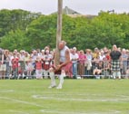 image of tossing the caber